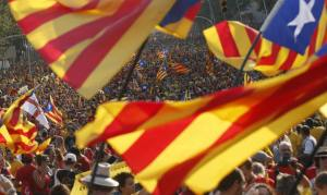 "People hold ""estelada"" flags, Catalan separatist flags, during a gathering to mark the Calatalonia day ""Diada"" in central Barcelona"