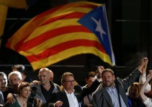 Catalan President Artur Mas gestures to Junts Pel Si (Together For Yes) supporters after polls closed in a regional parliamentary election in Barcelona